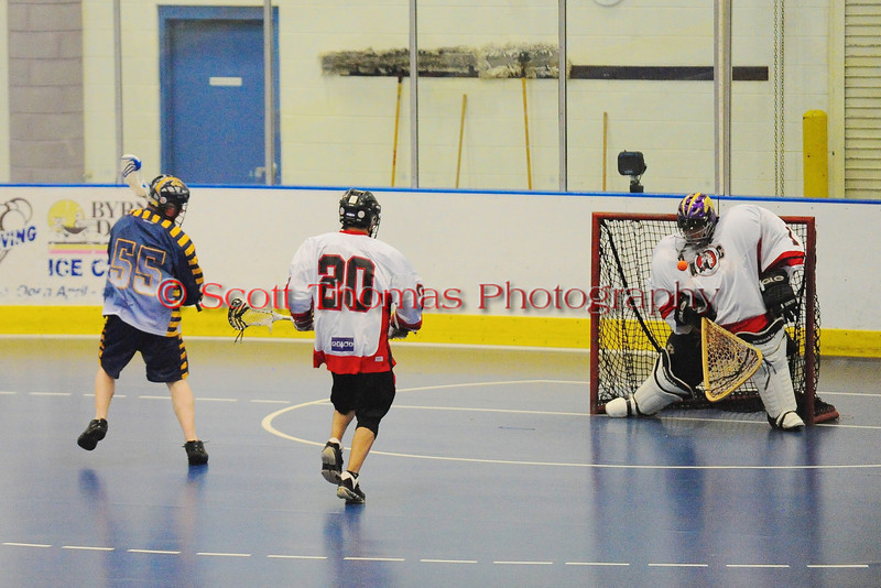 """Onondaga Red Hawks goalie Tyle Gabriel (1) makes a save against the Allegany Arrows in Can-Am Senior """"B"""" Box Lacrosse league action at the Onondaga Nation Arena in Nedrow, New York on Sunday, June 26, 2011.  Redhawks won 30-4."""