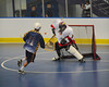 "Allegany Arrows John Abrams (11) is stopped by Onondaga Redhawks goalie Tyler Gabriel (1) in Can-Am Senior ""B"" Box Lacrosse league action at the Onondaga Nation Arena in Nedrow, New York on Sunday, June 26, 2011.  Redhawks won 30-4."