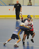 "Allegany Arrows try to stop an Onondaga Redhawk from clearing the ball in Can-Am Senior ""B"" Box Lacrosse league action at the Onondaga Nation Arena in Nedrow, New York on Sunday, June 26, 2011.  Redhawks won 30-4."