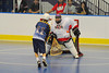 """Allegany Arrows John Abrams Jr. (11) is stopped by Onondaga Red Hawks goalie Tyler Gabriel (1) in Can-Am Senior """"B"""" Box Lacrosse league action at the Onondaga Nation Arena in Nedrow, New York on Sunday, June 26, 2011.  Redhawks won 30-4."""