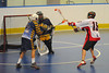 "Onondaga Redhawks Grant Bucktooth (15) sidesteps an Allegany Arrows defender before scoring a goal in Can-Am Senior ""B"" Box Lacrosse league action at the Onondaga Nation Arena in Nedrow, New York on Sunday, June 26, 2011.  Redhawks won 30-4."