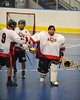 """Onondaga Red Hawks players congratulate goalie Tyler Gabriel after beating the Allegany Arrows in Can-Am Senior """"B"""" Box Lacrosse league action at the Onondaga Nation Arena in Nedrow, New York on Sunday, June 26, 2011.  Redhawks won 30-4."""