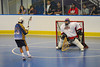 "Allegany Arrows player moves on Onondaga Red Hawks goalie Tyler Gabriel (1) in Can-Am Senior ""B"" Box Lacrosse league action at the Onondaga Nation Arena in Nedrow, New York on Sunday, June 26, 2011.  Redhawks won 30-4."