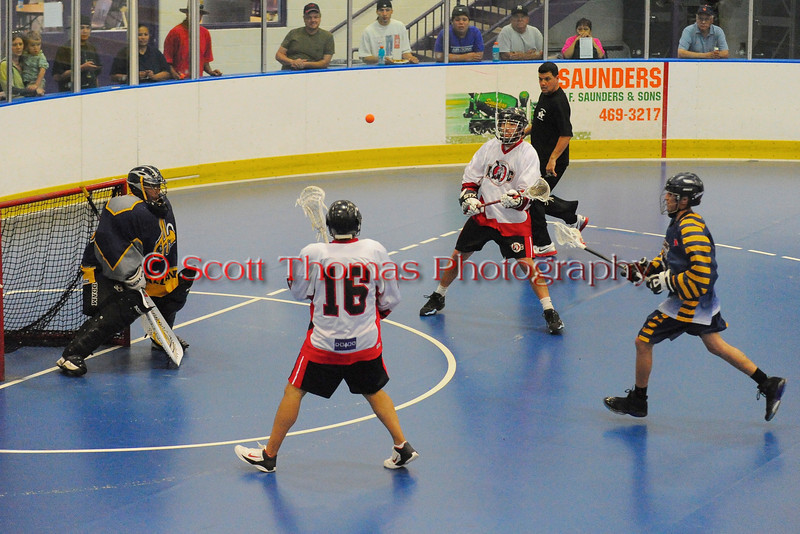 "Onondaga Redhawks Neal Powless (16) prepares to take a pass against the Allegany Arrows in Can-Am Senior ""B"" Box Lacrosse league action at the Onondaga Nation Arena in Nedrow, New York on Sunday, June 26, 2011.  Redhawks won 30-4."