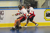 "Onondaga Red Hawks players Mike Abrams (7) and Ron cogna (9) check an Allegany Arrows players in Can-Am Senior ""B"" Box Lacrosse league action at the Onondaga Nation Arena in Nedrow, New York on Sunday, June 26, 2011.  Redhawks won 30-4."