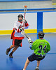 "Onondaga Red Hawks Mike Lazore (5) passes over Rochester Greywolves defender Sean Gilles (24) in Can-Am Senior ""B"" Box Lacrosse playoff action at the Onondaga Nation Arena in Nedrow, New York on Friday, July 15, 2011.  Greywolves won 12-8."