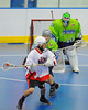 "Onondaga Red Hawks Tyler Hill (14) looks to make a play against the Rochester Greywolves in Can-Am Senior ""B"" Box Lacrosse playoff action at the Onondaga Nation Arena in Nedrow, New York on Friday, July 15, 2011.  Greywolves won 12-8."