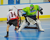 "Onondaga Red Hawks Tyler Hill (14) scores against Rochester Greywolves goalie Cory Bazylewski (00)  in Can-Am Senior ""B"" Box Lacrosse playoff action at the Onondaga Nation Arena in Nedrow, New York on Friday, July 15, 2011.  Greywolves won 12-8."