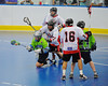 "Rochester Greywolves Bobby Defreeze (13) being checked by Onondaga Red Hawks defenders in Can-Am Senior ""B"" Box Lacrosse playoff action at the Onondaga Nation Arena in Nedrow, New York on Friday, July 15, 2011.  Greywolves won 12-8."