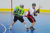 """Rochester Greywolves Dave Wood (15) defending against a Onondaga Red Hawks player in Can-Am Senior """"B"""" Box Lacrosse playoff action at the Onondaga Nation Arena in Nedrow, New York on Friday, July 15, 2011.  Greywolves won 12-8."""