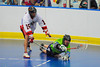 "Rochester Greywolves Sean Gilles (24) is checked by Onondaga Red Hawks Grant Bucktooth (15) in Can-Am Senior ""B"" Box Lacrosse playoff action at the Onondaga Nation Arena in Nedrow, New York on Friday, July 15, 2011.  Greywolves won 12-8. Players 15 & 24."