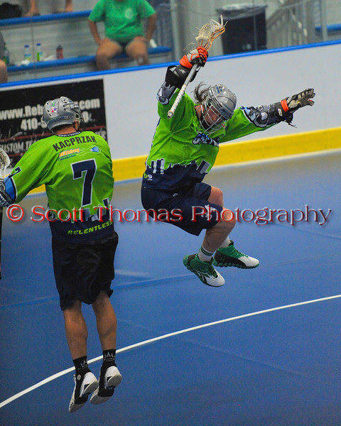 "Rochester Greywolves teammates Ryan Maciaszek (34) and Josh Kacprzak (7) celebrate Ryan's third period goal aganst the Onondaga Red Hawks in Can-Am Senior ""B"" Box Lacrosse playoff action at the Onondaga Nation Arena in Nedrow, New York on Friday, July 15, 2011.  Greywolves won 12-8."