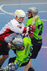 "Rochester Greywolves Steve Personale (29) gets checked by Onondaga Red Hawks Alex Cook (2) in Can-Am Senior ""B"" Box Lacrosse playoff action at the Onondaga Nation Arena in Nedrow, New York on Friday, July 15, 2011.  Greywolves won 12-8."