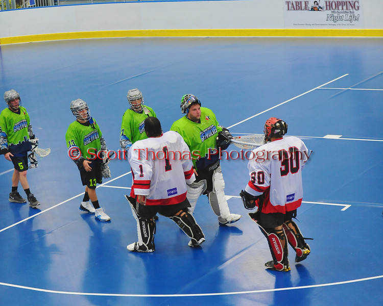 """Rochester Greywolves and Onondaga Red Hawks players shake hand after a Can-Am Senior """"B"""" Box Lacrosse playoff game at the Onondaga Nation Arena in Nedrow, New York on Friday, July 15, 2011.  Greywolves won 12-8."""