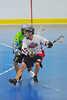 "Onondaga Red Hawks Wade Bucktooth (19) setting up a shot in front of the Rochester Greywolves net in Can-Am Senior ""B"" Box Lacrosse playoff action at the Onondaga Nation Arena in Nedrow, New York on Friday, July 15, 2011.  Greywolves won 12-8."