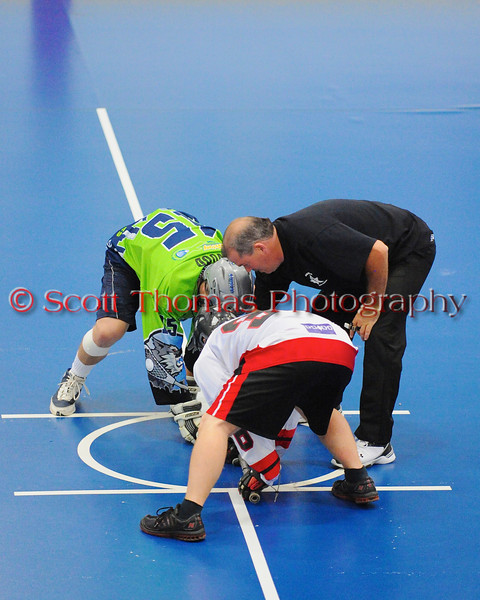 """Opening face-off between the Rochester Greywolves (green) and the Onondaga Red Hawks (white) in Can-Am Senior """"B"""" Box Lacrosse playoff action at the Onondaga Nation Arena in Nedrow, New York on Friday, July 15, 2011.  Greywolves won 12-8."""