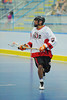 "Onondaga Red Hawks Mike Abrams (7) carries the ball against the Rochester Greywolves in Can-Am Senior ""B"" Box Lacrosse playoff action at the Onondaga Nation Arena in Nedrow, New York on Friday, July 15, 2011.  Greywolves won 12-8."
