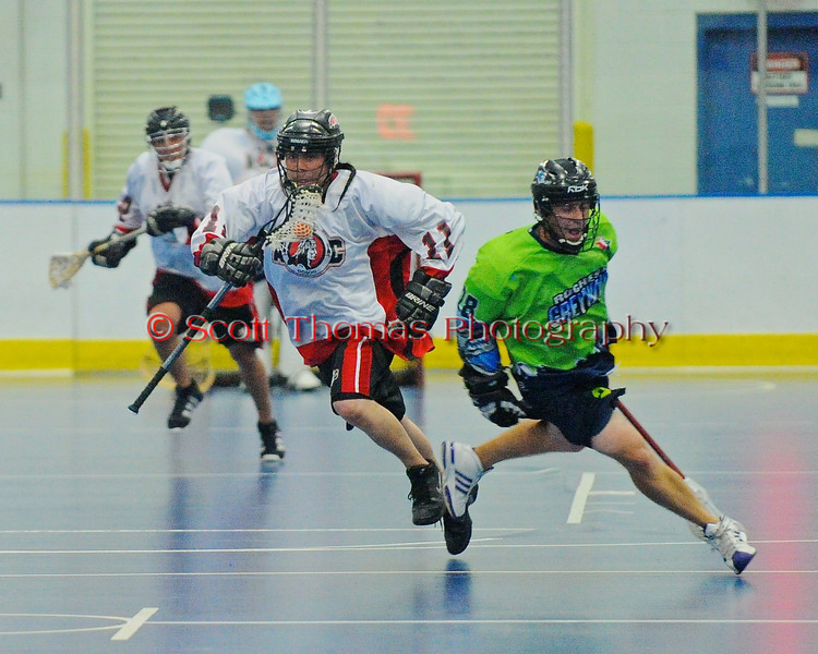 "Onondaga Red Hawks Clayton Jones (11) heads into the Rochester Greywolves zone in Can-Am Senior ""B"" Box Lacrosse playoff action at the Onondaga Nation Arena in Nedrow, New York on Friday, July 15, 2011.  Greywolves won 12-8."