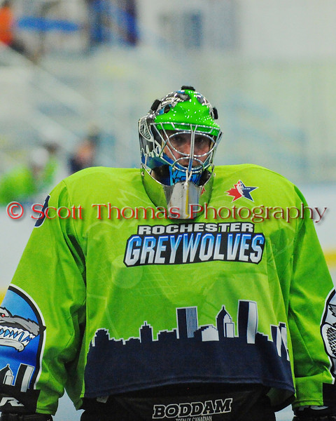 """Rochester Greywolves goalie Cory Bazylewski (00) walking to his net before the start of the second period in a game against Onondaga Red Hawks in Can-Am Senior """"B"""" Box Lacrosse playoff action at the Onondaga Nation Arena in Nedrow, New York on Friday, July 15, 2011.  Greywolves won 12-8."""