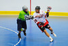"Onondaga Red Hawks Neal Powless (16) being watched by Rochester Greywolves Steve Personale (29) in Can-Am Senior ""B"" Box Lacrosse playoff action at the Onondaga Nation Arena in Nedrow, New York on Friday, July 15, 2011.  Greywolves won 12-8."