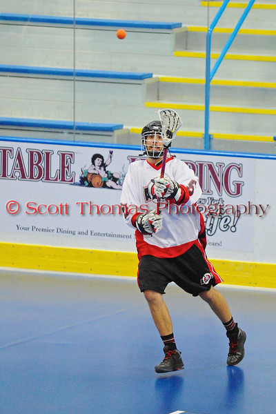 """Onondaga Red Hawks makes a pass against the Rochester Greywolves in Can-Am Senior """"B"""" Box Lacrosse playoff action at the Onondaga Nation Arena in Nedrow, New York on Friday, July 15, 2011.  Greywolves won 12-8."""