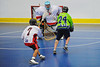 """Rochester Greywolves Sean Gilles (24) shoots and scores agianst the the Onondaga Red Hawks in Can-Am Senior """"B"""" Box Lacrosse playoff action at the Onondaga Nation Arena in Nedrow, New York on Friday, July 15, 2011.  Greywolves won 12-8."""