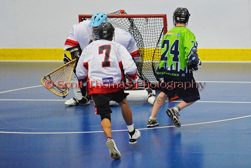 "Rochester Greywolves Sean Gilles (24) shoots and scores agianst the the Onondaga Red Hawks in Can-Am Senior ""B"" Box Lacrosse playoff action at the Onondaga Nation Arena in Nedrow, New York on Friday, July 15, 2011.  Greywolves won 12-8."