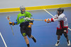 """Rochester Greywolves Adam Nauerth (27) getting stick checked by Onondaga Red Hawks defender Mike Abrams (7) in Can-Am Senior """"B"""" Box Lacrosse playoff action at the Onondaga Nation Arena in Nedrow, New York on Friday, July 15, 2011.  Greywolves won 12-8."""