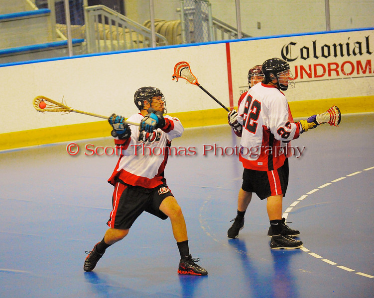 Onondaga Redhawks Ron Cogan (9) leaning into a shot against the Buffalo Creek Thunder at the Onondaga Nation Arena near Nedrow, New York on Sunday, June 17, 2012.