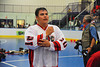 "Onondaga Redhawks Pete Benedict (10) waiting to shake hands with the Newtown Golden Eagles after winning the Can-Am Senior ""B"" Box Lacrosse finals at the Onondaga Nation Arena near Nedrow, New York."