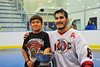 "Onondaga Redhawks Brett Bucktooth (66) and son with the Stanley ""Butch"" Jimerson Can-Am Lacrosse Champions Cup."