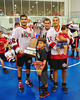 "Onondaga Redhawks Brett Bucktooth (66) and Grant Bucktooth (15) with their sons and the Stanley ""Butch"" Jimerson Can-Am Lacrosse Champions Cup after defeating the Newtown Golden Eagles in the Can-Am Senior ""B"" Box Lacrosse finals at the Onondaga Nation Arena near Nedrow, New York."