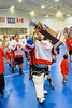 "Onondaga Redhawks Spencer Lyons (1) parading the Stanley ""Butch"" Jimerson Can-Am Lacrosse Champions Cup after defeating the Newtown Golden Eagles in the Can-Am Senior ""B"" Box Lacrosse finals at the Onondaga Nation Arena near Nedrow, New York."