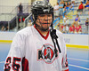 "Onondaga Redhawks Kevin Bucktooth (25) waiting to shake hands with the Newtown Golden Eagles after winning the Can-Am Senior ""B"" Box Lacrosse finals at the Onondaga Nation Arena near Nedrow, New York."