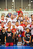 "Onondaga Redhawks celebrating with the Stanley ""Butch"" Jimerson Can-Am Lacrosse Champions Cup after defeating the Newtown Golden Eagles in the Can-Am Senior ""B"" Box Lacrosse finals at the Onondaga Nation Arena near Nedrow, New York."