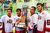 "Onondaga Redhawks captains Dustin Hill (20), Neal Powless (16), David Stout (24) and Brett Bucktooth (66) with the Stanley ""Butch"" Jimerson Can-Am Lacrosse Champions Cup after defeating the Newtown Golden Eagles in the Can-Am Senior ""B"" Box Lacrosse finals at the Onondaga Nation Arena near Nedrow, New York."