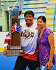 "Onondaga Redhawks Neal Powless (16) with the Stanley ""Butch"" Jimerson Can-Am Lacrosse Champions Cup after defeating the Newtown Golden Eagles in the Can-Am Senior ""B"" Box Lacrosse finals at the Onondaga Nation Arena near Nedrow, New York."