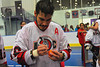"Onondaga Redhawks Brett Bucktooth (66) autographing a lacrosse ball for young fans after defeating the Newtown Golden Eagles in the Can-Am Senior ""B"" Box Lacrosse finals at the Onondaga Nation Arena near Nedrow, New York."