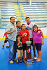 "Onondaga Redhawks Dwayne Porter (23) and his family with the Stanley ""Butch"" Jimerson Can-Am Lacrosse Champions Cup at the Onondaga Nation Arena near Nedrow, New York."
