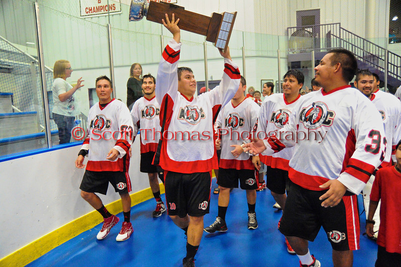 """Onondaga Redhawks parading the Stanley """"Butch"""" Jimerson Can-Am Lacrosse Champions Cup after defeating the Newtown Golden Eagles in the Can-Am Senior """"B"""" Box Lacrosse finals at the Onondaga Nation Arena near Nedrow, New York."""