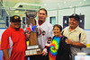 "Onondaga Redhawks James Cathers (22) posing with his family and the Stanley ""Butch"" Jimerson Can-Am Lacrosse Champions Cup after defeating the Newtown Golden Eagles in the Can-Am Senior ""B"" Box Lacrosse finals at the Onondaga Nation Arena near Nedrow, New York."