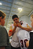 "Onondaga Redhawks Ross Bucktooth (30) autographing a lacrosse ball for young fans after defeating the Newtown Golden Eagles in the Can-Am Senior ""B"" Box Lacrosse finals at the Onondaga Nation Arena near Nedrow, New York."