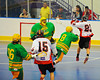 """Onondaga Redhawks Dwayne Porter (23) jumping up for a shot against the Newtown Golden Eagles in a Can-Am Senior """"B"""" box lacrosse game at the Onondaga Nation Arena (Tsha'hon'nonyen'dakhwa') near Nedrow, New York on Saturday, May 12, 2012."""