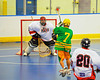 """Newtown Golden Eagles Donald Stevens (7) closes in on the Onondaga Redhawks goal in a Can-Am Senior """"B"""" box lacrosse game at the Onondaga Nation Arena (Tsha'hon'nonyen'dakhwa') near Nedrow, New York on Saturday, May 12, 2012."""
