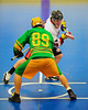 "Onondaga Redhawks James Cathers (22) wins a face-off against the Newtown Golden Eagles Linden Stevens (89) in a Can-Am Senior ""B"" box lacrosse game at the Onondaga Nation Arena (Tsha'hon'nonyen'dakhwa') near Nedrow, New York on Saturday, May 12, 2012."