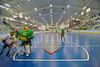 """Newtown Golden Eagles goalie grabs the ball before an Onondaga Redhawks player in a Can-Am Senior """"B"""" box lacrosse game at the Onondaga Nation Arena (Tsha'hon'nonyen'dakhwa') near Nedrow, New York on Saturday, May 12, 2012."""