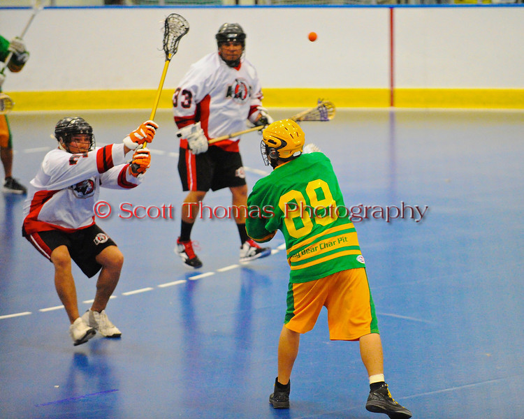 "Newtown Golden Eagles Linden Stevens (89) passes to a teammate agaisnt the Onondaga Redhawks in a Can-Am Senior ""B"" box lacrosse game at the Onondaga Nation Arena (Tsha'hon'nonyen'dakhwa') near Nedrow, New York on Saturday, May 12, 2012."
