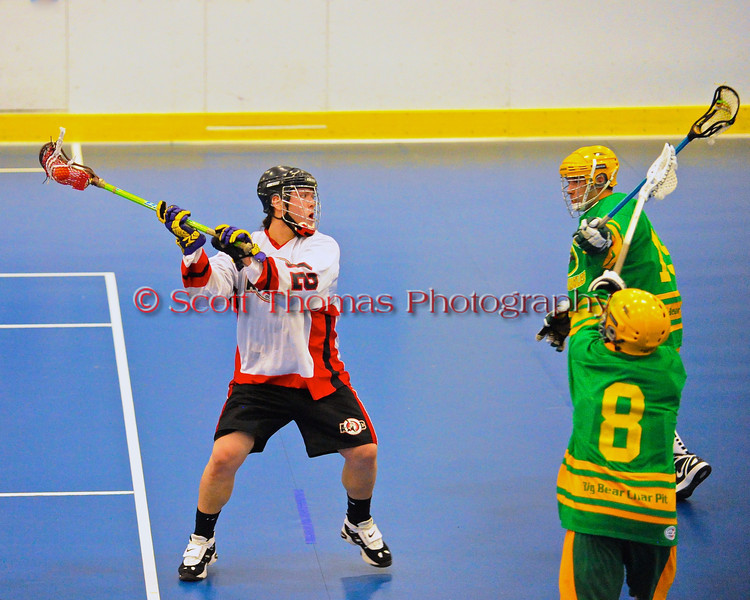 """Onondaga Redhawks James Cathers (22) winding up for a shot against the Newtown Golden Eagles in a Can-Am Senior """"B"""" box lacrosse game at the Onondaga Nation Arena (Tsha'hon'nonyen'dakhwa') near Nedrow, New York on Saturday, May 12, 2012."""
