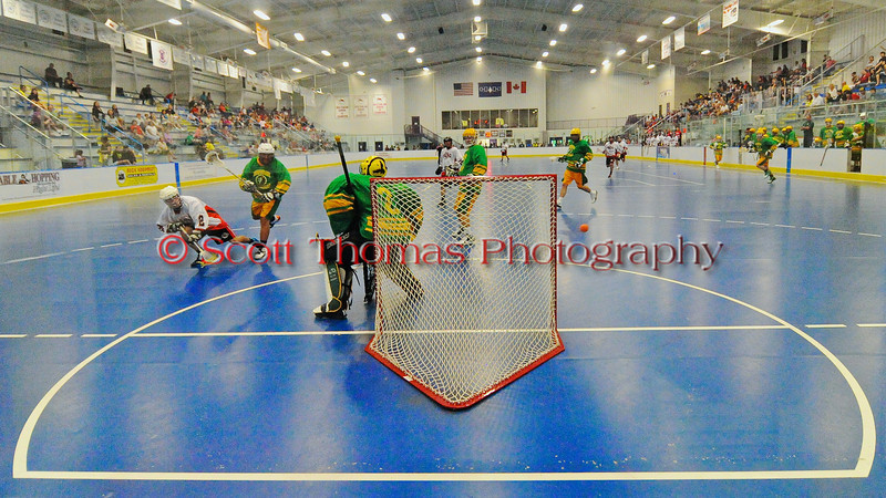 """Onondaga Redhawks Trevor Clark (2) fires a shot wide of the Newtown Golden Eagles goal in a Can-Am Senior """"B"""" box lacrosse game at the Onondaga Nation Arena (Tsha'hon'nonyen'dakhwa') near Nedrow, New York on Saturday, May 12, 2012."""