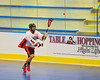 """Onondaga Redhawks Dave Limbouris (5) flips a pass to a teammate against the Newtown Golden Eagles in a Can-Am Senior """"B"""" box lacrosse game at the Onondaga Nation Arena (Tsha'hon'nonyen'dakhwa') near Nedrow, New York on Saturday, May 12, 2012."""